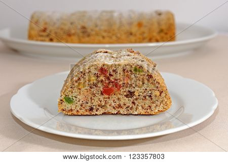 Homemade fruitcake with candied fruit on a white plate Easter tradition sweet
