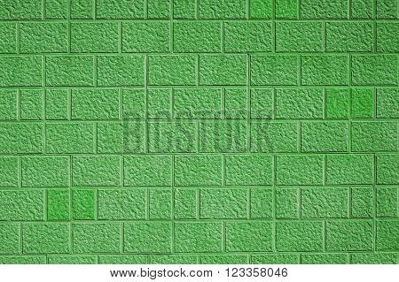 Green sand stone effect bricks / blocks wall background texture.