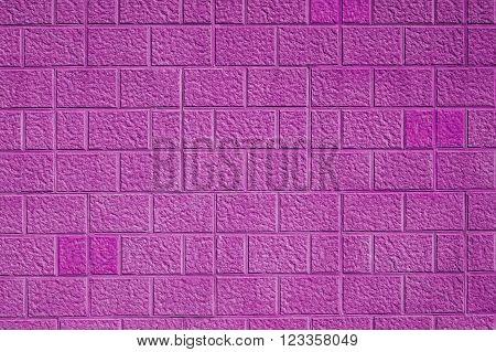 Pink sand stone effect bricks / blocks wall background texture.