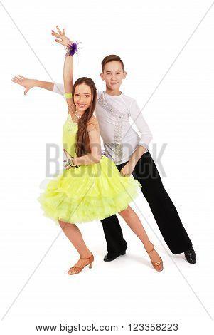 Boy and girl dancing ballroom dance on white background