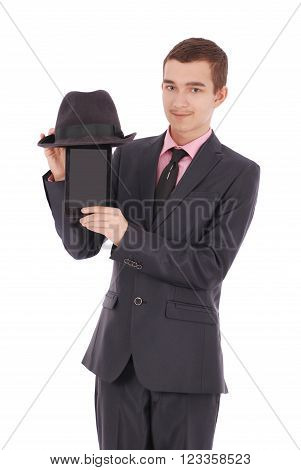 Boy in a black suit holds a tablet PC fun isolated on white