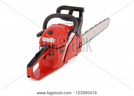 Red professional chainsaw isolated on white background