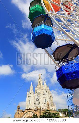 BARCELONA SPAIN - SEPTEMBER 15 2014: Ferris Wheel and Church in Mount Tibidabo, Barcelona, Spain