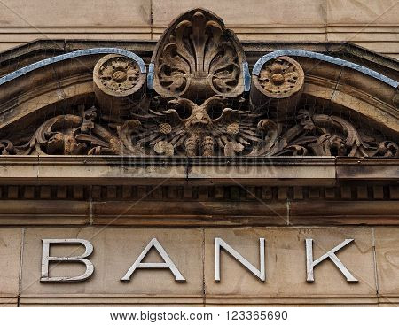 Stone bank sign over the portal of a bank