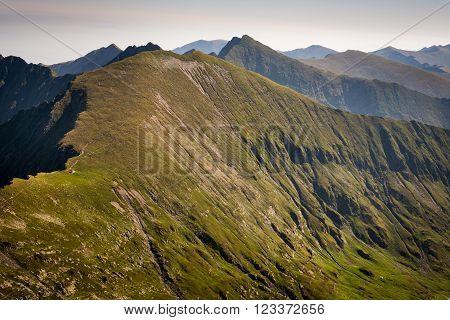 Mountainside in Romania, Fagaras, Carpathians, landscape with grey sky