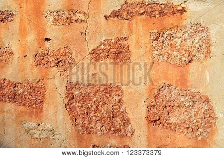 Architectural vintage background - aged orange textured wall made of ancient stone