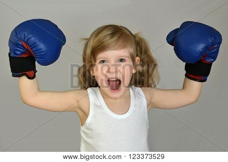 A little girl (child, kid) in Boxing gloves