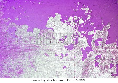Magenta painted metal background. Peeling paint on the old rough steel surface