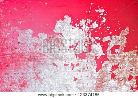 Textured metal aged background - bright red surface metal sheet plate with peeling paint