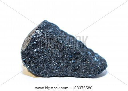 Uncut, rough and raw dark blue Apatite gemstone isolated on white background
