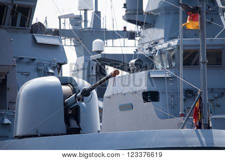 WARNEMUENDE / MECKLENBURG- WEST POMERANIA - JUNE 2015: cannon on german corvette at open day presentation in naval base, warnemuende / germany circa June 2015.