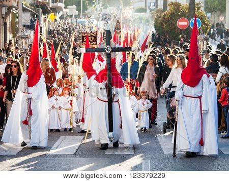 Algeciras Spain - 20 March 2016 Participants of the Palm Sunday procession. The penitents wear the typical conicle hoods