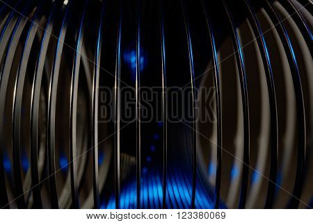 A shiny, curved spring blue studio lighting reflection