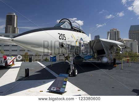 SAN DIEGO California USA - March 13 2016: aircraft carrier USS Midway (CV-41) F-14 Tomcat on flying deck museum in San Diego harbour USA