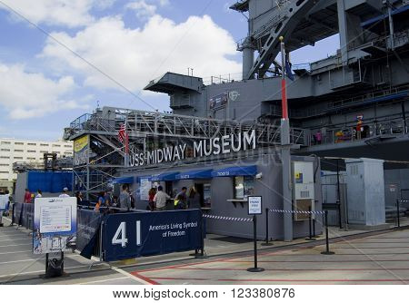 SAN DIEGO California USA - March 13 2016: aircraft carrier USS Midway (CV-41) entrance to museum museum in San Diego harbour USA