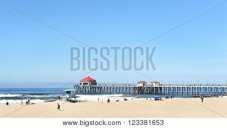 HUNTINGTON BEACH, CA - MARCH 25, 2015: Huntington Beach pier and coastline looking out over the ocean.