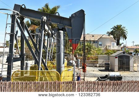 HUNTINGTON BEACH, CA - MARCH 25, 2015: Residential Oil Well. Oil wells and tanks are a common sight in the beach city.