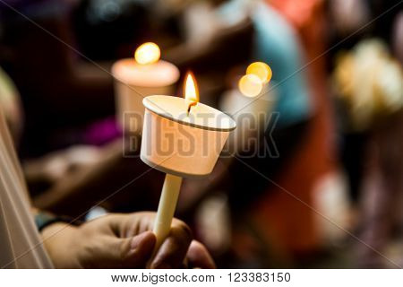 Closeup Of People Holding Candle Vigil In Dark Seeking Hope
