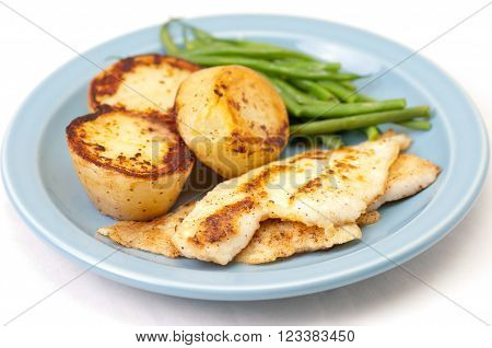 healthy pan fried fillet of sole with lime sauce roasted potatoes and green vegetables