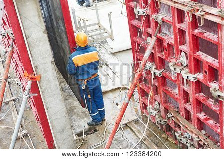 Worker disassemble falsework construction