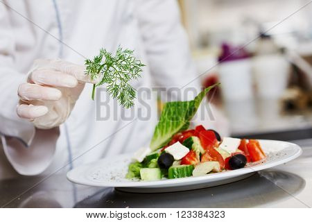 cook chef hand decorating prepared salad food