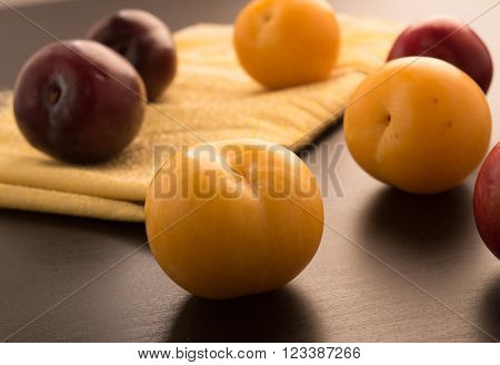 Sweet plums arranged on a black background