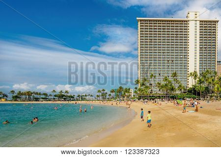 Waikiki, Honolulu, Hawaii, USA - December 13, 2015: Waikiki Beach and Hilton Hotel on a sunny afternoon. The beach area was not as crowded with visitors as originally anticipated.