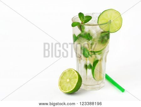 mojito cocktail with lime and mint in tumbler glass on white background with copy space