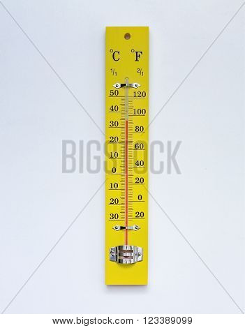 Yellow thermometer for temperature on white background.