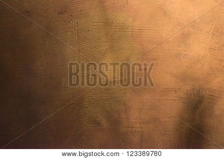 Old scratched and chapped painted gold and orange wall. Abstract textured colored background, empty template