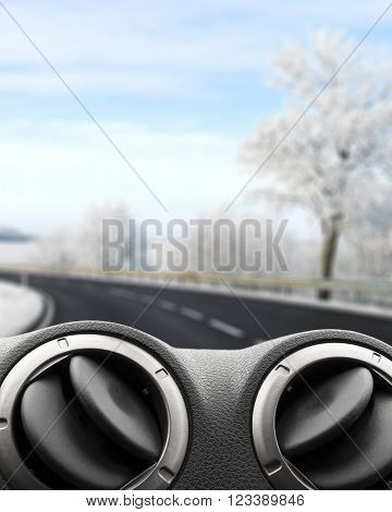 View from the car on the road with winter landscape