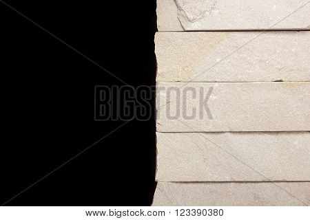 Retaining walls of gray stone on a black background