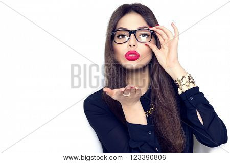 Beauty fashion sexy girl wearing glasses showing empty copy space on the open hand palm for text, white background. Happy girl presenting point. Proposing product. Advertisement gesture