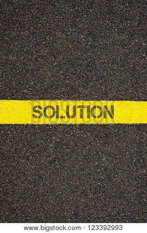 Road marking yellow paint dividing line with word SOLUTION, concept image