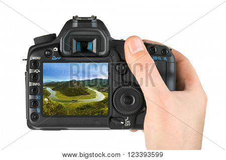 Hand with camera and Rijeka Crnojevica River - Montenegro image (my photo) isolated on white background