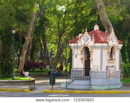 SAN JOSE, COSTA RICA - March 21: Spain Park, a city park in San Jose Downtown. It has several  different tropical vegetation and a small kiosk. March 21, 2016 in San Jose.