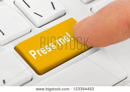 Computer notebook keyboard with Press me key - technology background