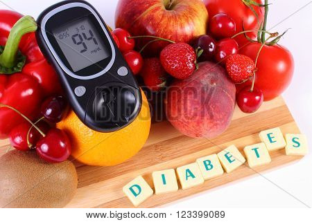 Glucose meter with fresh ripe fruits and vegetables on wooden cutting board, concept of diabetes, healthy food, nutrition and strengthening immunity