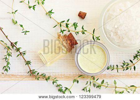 Aroma oil, facial cream, sea salt. Fresh thyme herbs. Herbal remedies.