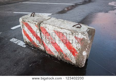 Broken Concrete Road Block With Striped Pattern