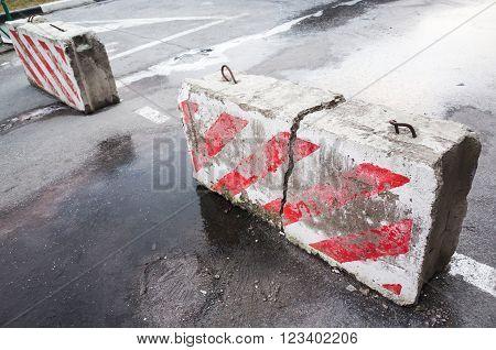 Broken Concrete Road Blocks On The Street