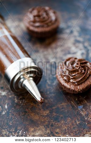 Fresh homemade chocolate cupcakes for Easter with chocolate frosting ** Note: Visible grain at 100%, best at smaller sizes