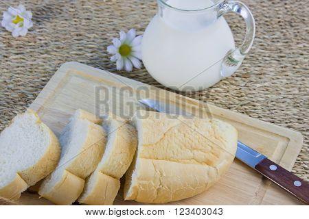 Fresh Cut Long Loaf And Milk In A Jug