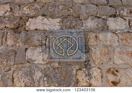 DUBROVNIK CROATIA - FEBRUARY 19 2016: World Heritage emblem on the city wall in Old Town of Dubrovnik Croatia. Dubrovnik was designated as World Heritage Site of UNESCO in 1979