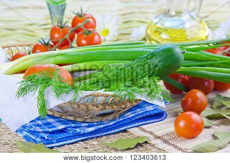 ripe red tomatoes and fresh greenery on a decorative napkin