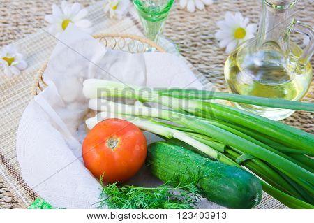Ripe Red Tomatoes And Fresh Greenery