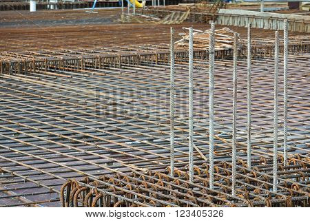 SEPANG, MALAYSIA -MARCH 23, 2016: Floor slab reinforcement bar on timber form work at the construction site in Selangor, Malaysia. The reinforcement bar fabricated by workers