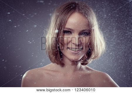 Happy smiling girl  smiles in rain and catches drops for your design