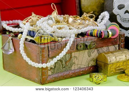 Small Box With Treasures On A Light Green Background