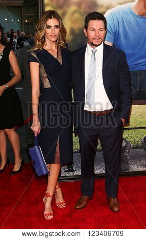NEW YORK-JUN 24: Mark Wahlberg and wife Rhea Durham (R) attend the 'Ted 2' world premiere at the Ziegfeld Theatre on June 24, 2015 in New York City.